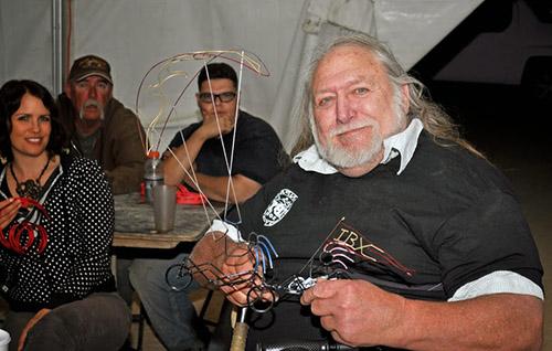 Casey Jones with a generous winning bid for a Kokopeli Kiter metal sculpture - photo John Chilese